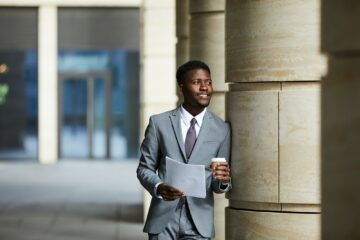 African businessman reading a document