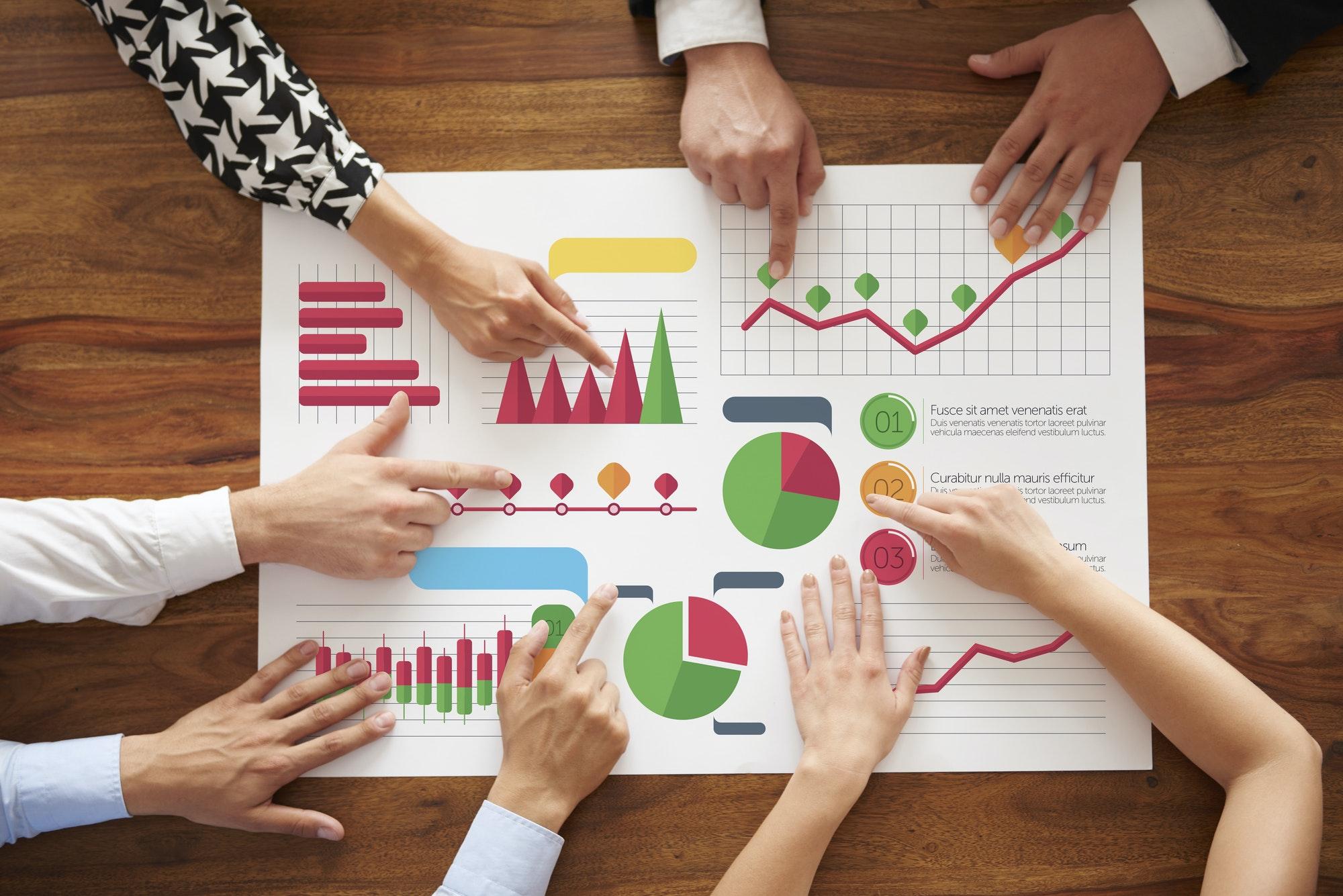 Business people analyzing many charts