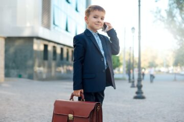 Future businessman with briefcase and phone