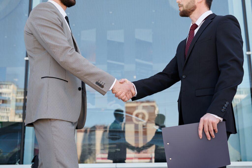 Men shaking hands outdoors