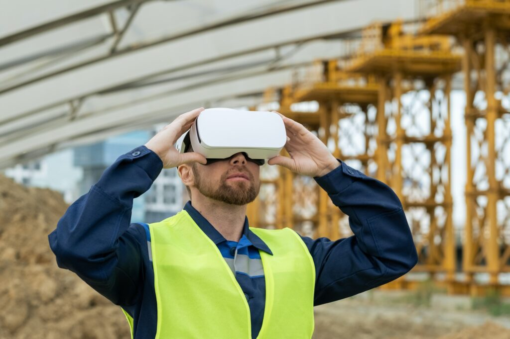 Serious builder in uniform and vr headset